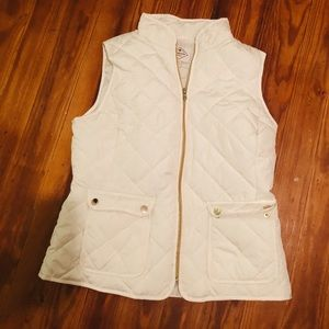 white vest with gold details